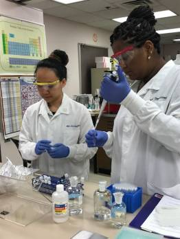 Two students in lab coats